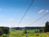 Summer landscape with electrical lines — Stock Photo