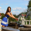 Girl at a fountain — Stock Photo