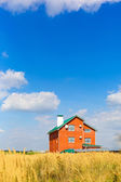 House with land — Stock Photo