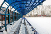 Seat on stands in winter — Stock Photo