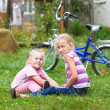 Stock Photo: Two girls playing on the green grass