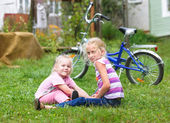 Two girls playing on the green grass — Stock Photo