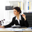 Business brunette girl in office — Stock Photo