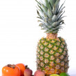 Tropical fruit. pineapple, lychees, lime, persimmon — Stock Photo #32659139