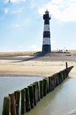 Lighthouse on a beach in Holland — Stock Photo