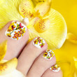 Stock Photo: Pedicure with yellow orchids.