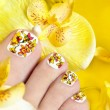 Pedicure with yellow orchids. — Stock Photo #23535523