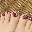 Burgundy pedicure. — Stock Photo