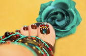 Brown turquoise design pedicure. — Stock Photo