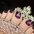 Stock Photo: Holiday elegant purple pedicure.