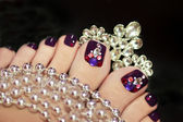 Holiday elegant purple pedicure. — Stock Photo