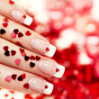 Stock Photo: Manicure with red heart .