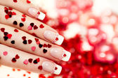 Manicure with a red heart . — Stock Photo