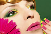 Makeup with gerberas. — Stock Photo