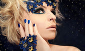 Luxurious blue manicure and makeup. — Stock Photo