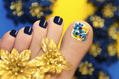 Blue pedicure with butterflies. — Stock Photo