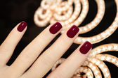 Luxury short manicure Burgundy . — Stock Photo