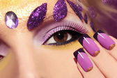 Purple makeup and nails. — Stock Photo