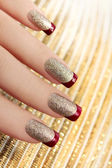 Brilliant Golden manicure — Stock Photo