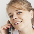 Pharmacist woman on phone - Stock Photo