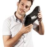 Man showing one shoe — Stock Photo #13429404