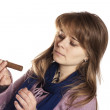 Girl looking at one cigar — Stock Photo