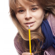 Girl holding a pencil — Stockfoto