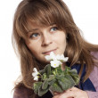 Woman holding white flowers — Stock Photo