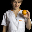 Woman with orange — Foto de stock #18035465