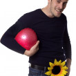 Man with one flower holding a ball - Stock Photo