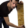 Man marking plank of wood — Stock Photo