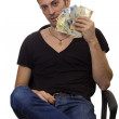 Stock Photo: Msit on chair and hold money