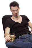 Man with glass of cognac — Stock Photo