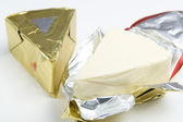 Triangle piece of cheese — Stock Photo