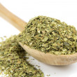 Oregano spice on wooden spoon - Stockfoto