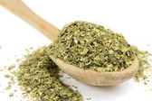 Oregano spice on wooden spoon — Stock Photo