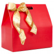 Red gift with gold bow — Stock Photo