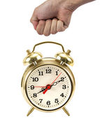 Man's hand in a fist about to hit a gold clock — Stock Photo