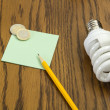 Light bulb with pencil and post-it — Zdjęcie stockowe