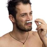 Man smelling a cigarette — Stock Photo