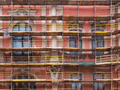 Old house in scaffolding — Stock Photo