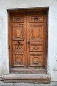 Vintage wooden door of the Tallinn city — Стоковое фото