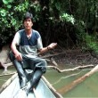 Indigenous Man fishing in the Amazon - Photo