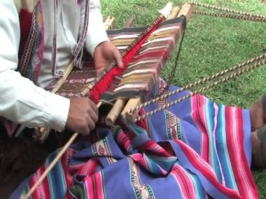 Man weaving a rug in Peru