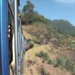 Ride the famous heritage stream train of India from Ooty to Coonoor through the narrow gauge Nilgiri Blue Mountains. — Stock Video #12904785