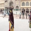 Stock Video: Womsand pans on head at Amber Fort