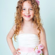 Cute curly child in white dress — Stock Photo