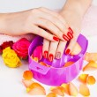 Stock Photo: Girl with bright red polish on nails in salon