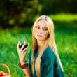 Girl on the grass with a glass of wine — Stock Photo