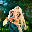 Attractive blonde woman holding watermelon outdoor — Φωτογραφία Αρχείου